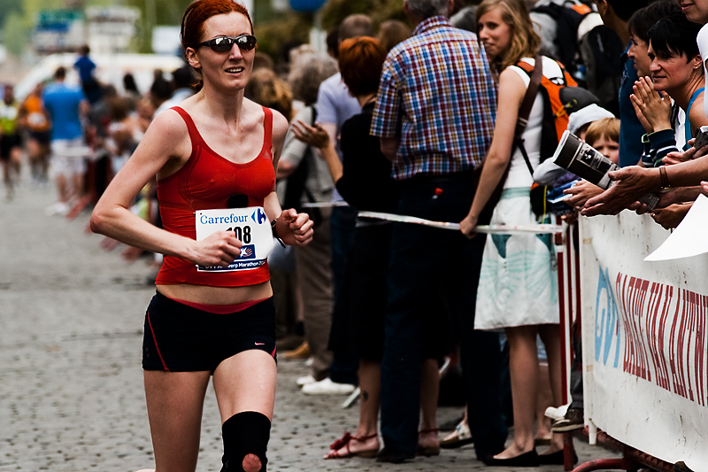A female runner nears the marathon's finish line. - Antwerp, Belgium - Daily Travel Photos