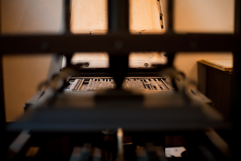 A close-up of a traditional printing press and plate at the Plantin-Moretus Museum.  - Antwerp, Belgium - Daily Travel Photos