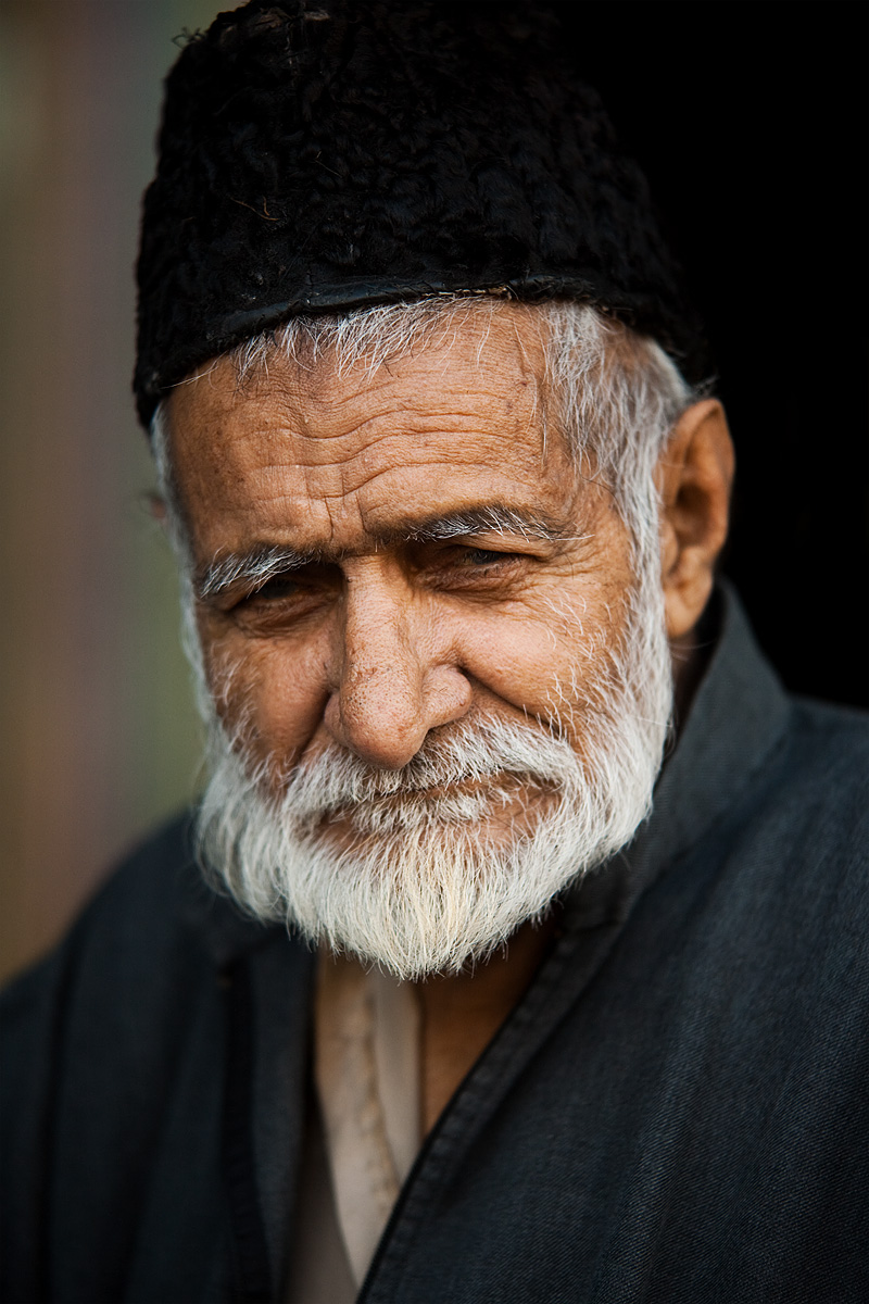 An older Kashmiri man stops to have his portrait taken.  - Srinagar, Kashmir, India - Daily Travel Photos