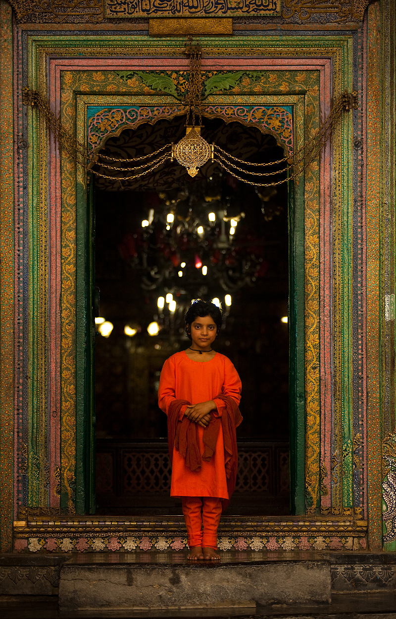 A young Kashmiri girl poses for a photo at the entrance to the Shah-e-Hamdan mosque. - Srinagar, Kashmir, India - Daily Travel Photos