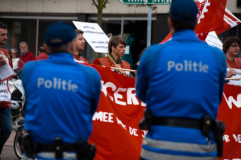 Marchers are seen between policemen on duty to monitor the parade. - Antwerp, Belgium - Daily Travel Photos