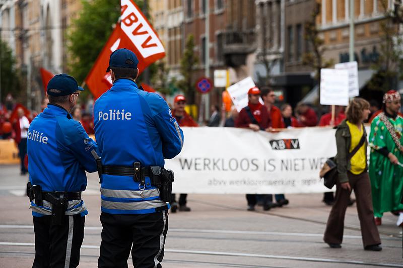 Belgian policemen monitor the May Day parade. - Antwerp, Belgium - Daily Travel Photos