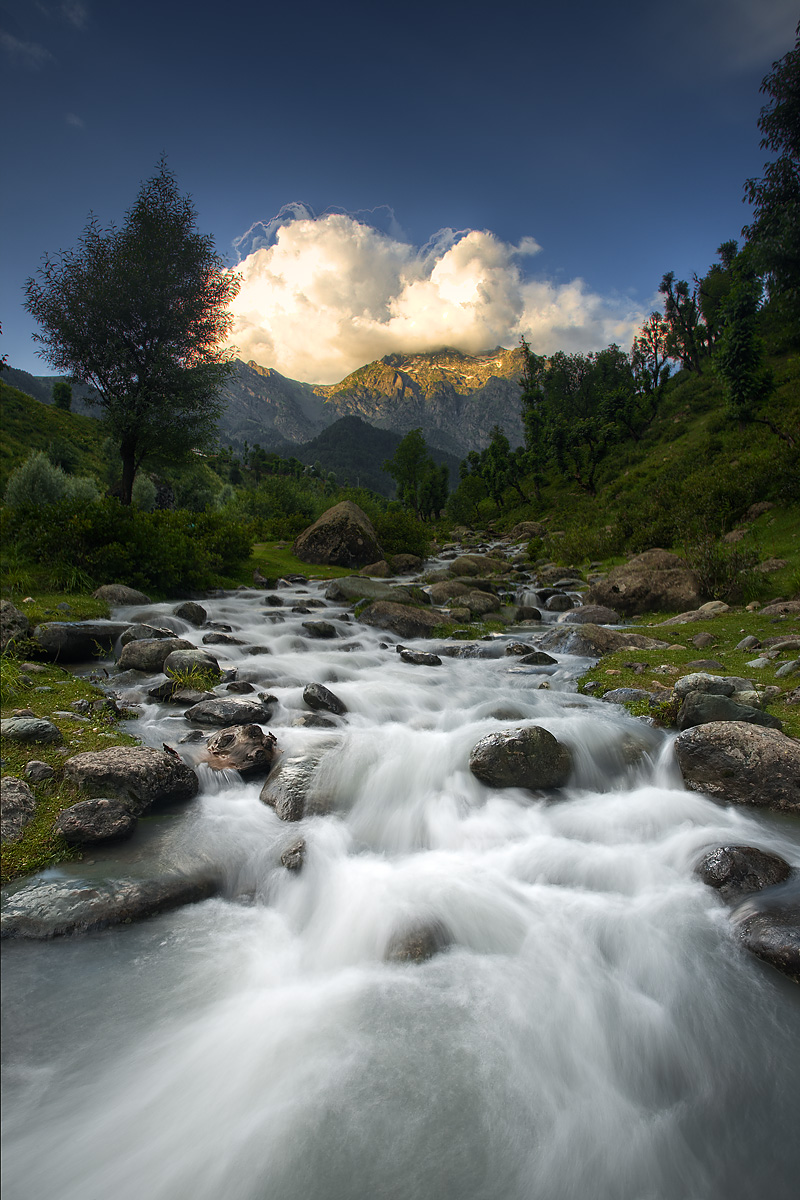 A stream flows down from the nearby snow-capped mountains. - Aru Valley, Kashmir, India - Daily Travel Photos