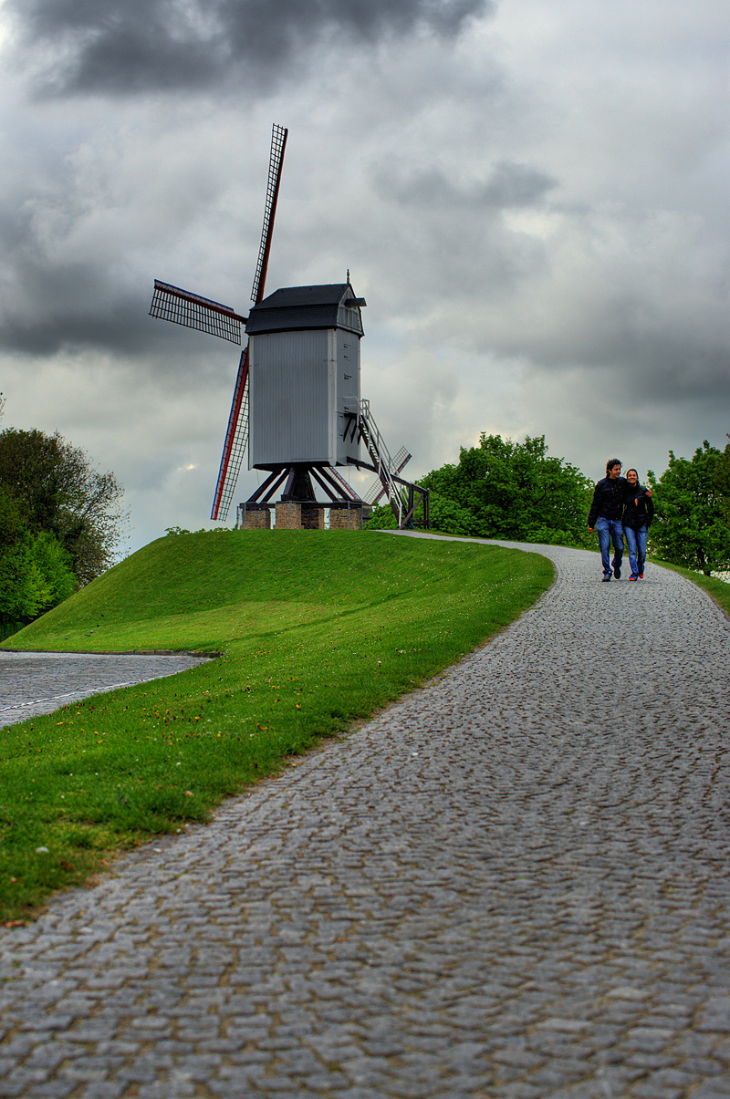 Tourists descend down a path after visiting a model windmill. - Brugge, Belgium - Daily Travel Photos