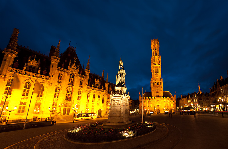 A statue in Grote Markt is backed by the provincial courthouse and belfry.  - Brugge, Belgium - Daily Travel Photos