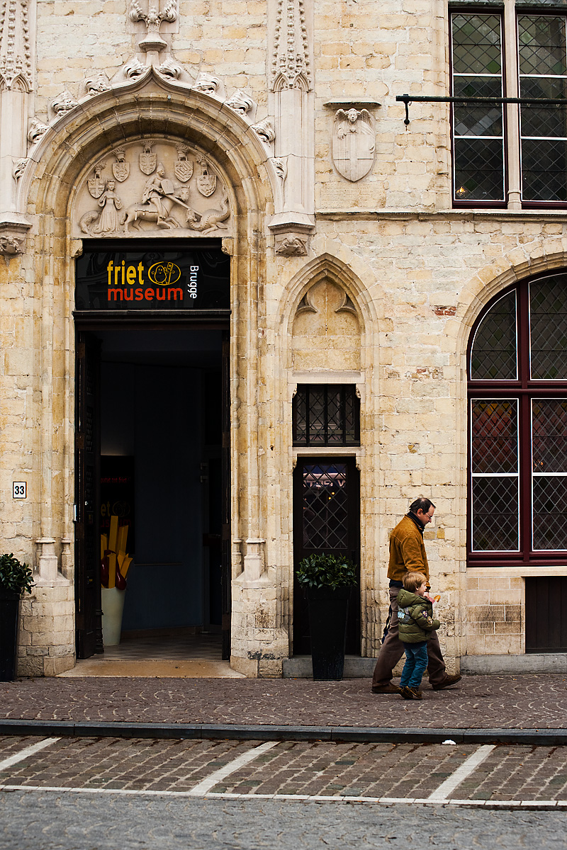 Satisfied customers exit the Friet Museum. - Brugge, Belgium - Daily Travel Photos