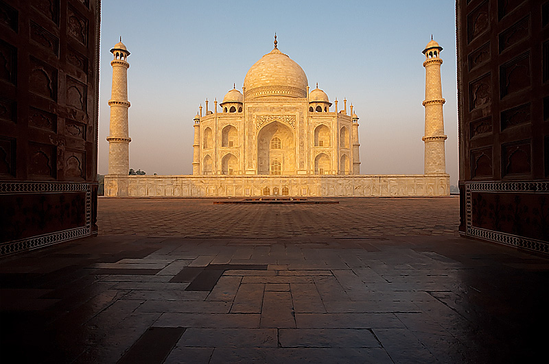 The Taj Mahal at sunrise is seen through the doors of the Jawab. - Agra, Uttar Pradesh, India - Daily Travel Photos