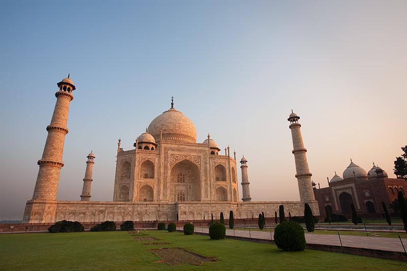 An empty Taj Mahal and its neighboring building, the Jawab, at sunrise. - Agra, Uttar Pradesh, India - Daily Travel Photos