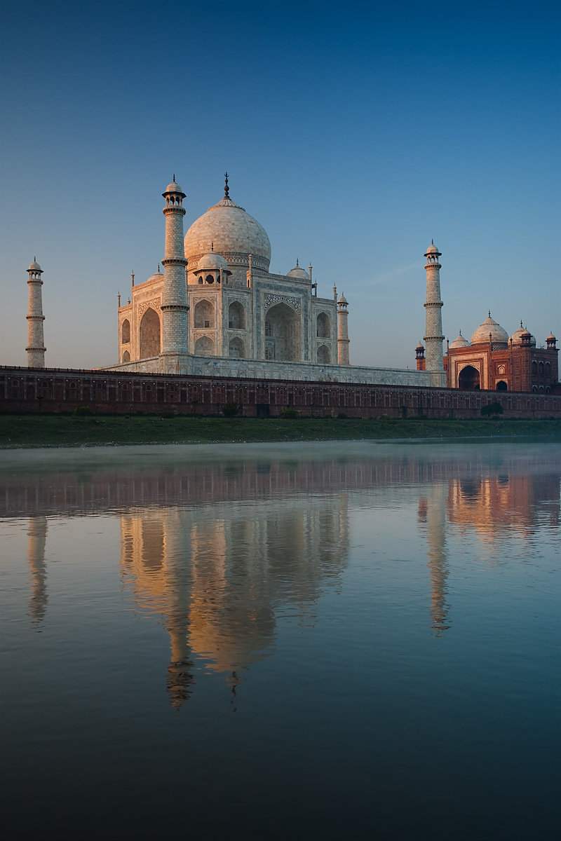 The Taj Mahal's reflection is seen in the holy Jamuna River at sunrise.  - Agra, Uttar Pradesh, India - Daily Travel Photos