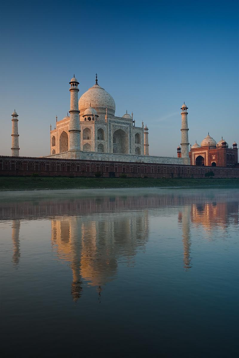 The Taj Mahal's reflection is seen in the holy Jamuna River at sunrise.  - Agra, Uttar Pradesh, India - Daily Travel Photos