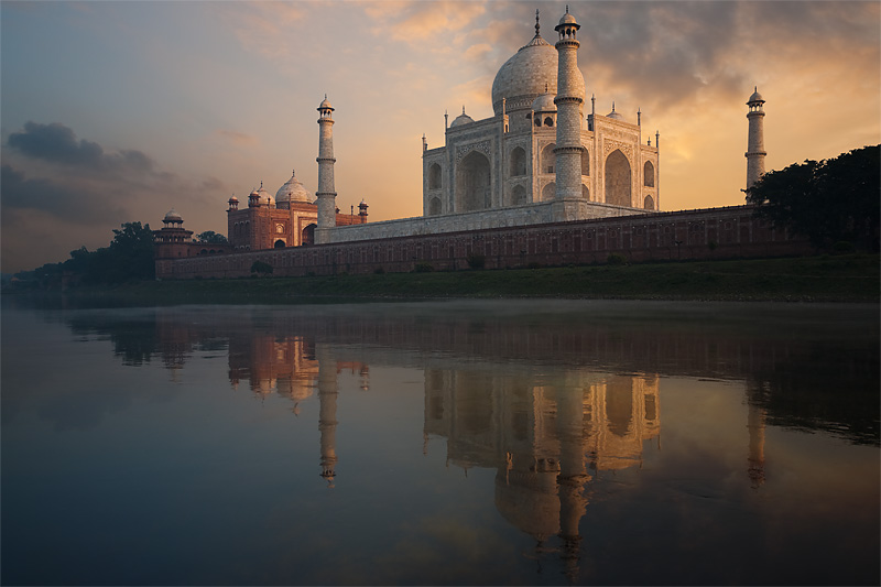 The Taj Mahal, seen from the holy Jamuna river, is reflected at sunset. - Agra, Uttar Pradesh, India - Daily Travel Photos