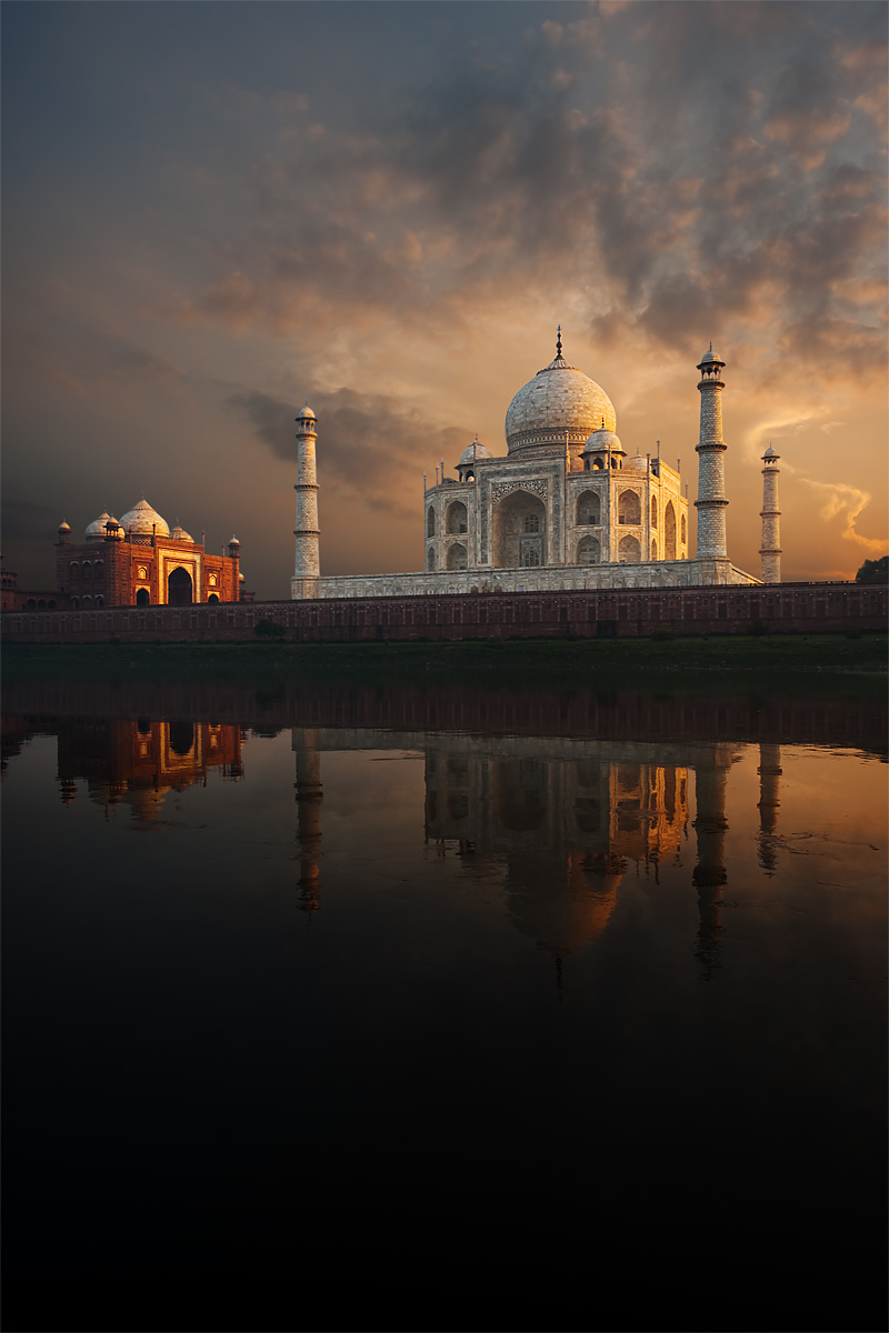 The holy Jamuna river reflects the sunset clouds and Taj Mahal. - Agra, Uttar Pradesh, India - Daily Travel Photos