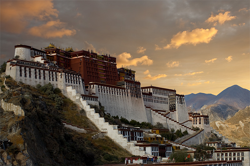 The Potala Palace shines during sunset, after rains. - Lhasa, Tibet - Daily Travel Photos