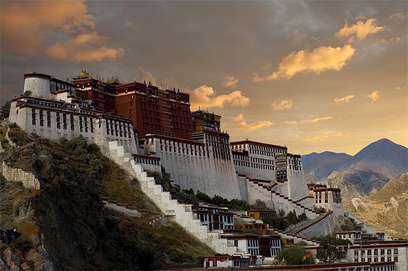 The Potala Palace shines during sunset, after rains. - Lhasa, Tibet - Daily Travel Photos