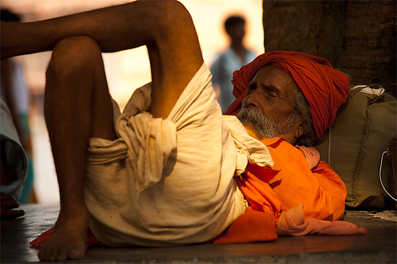 A sadhu naps in the shade. - Haridwar, Arunachal Pradesh, India - Daily Travel Photos