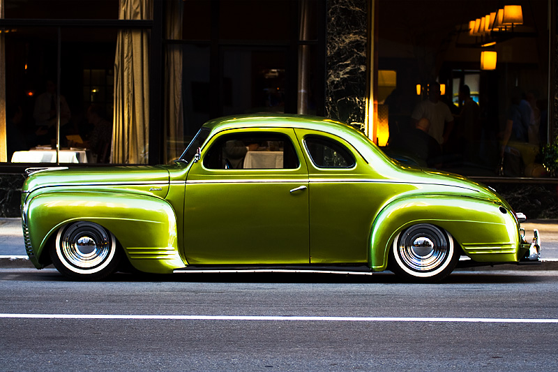 A vintage Plymouth Deluxe parked outside of a restaurant. - San Francisco, California, USA - Daily Travel Photos
