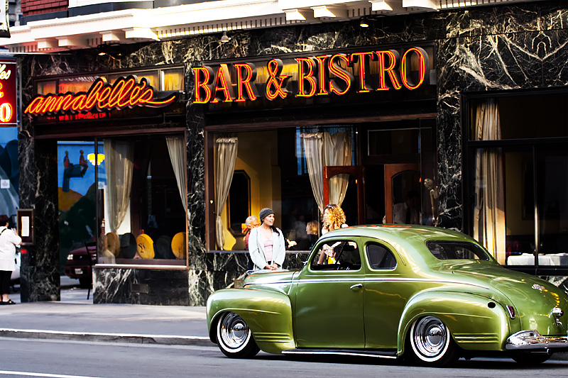 A green Plymouth Deluxe Coupe parked outside a restaurant. - San Francisco, California, USA - Daily Travel Photos