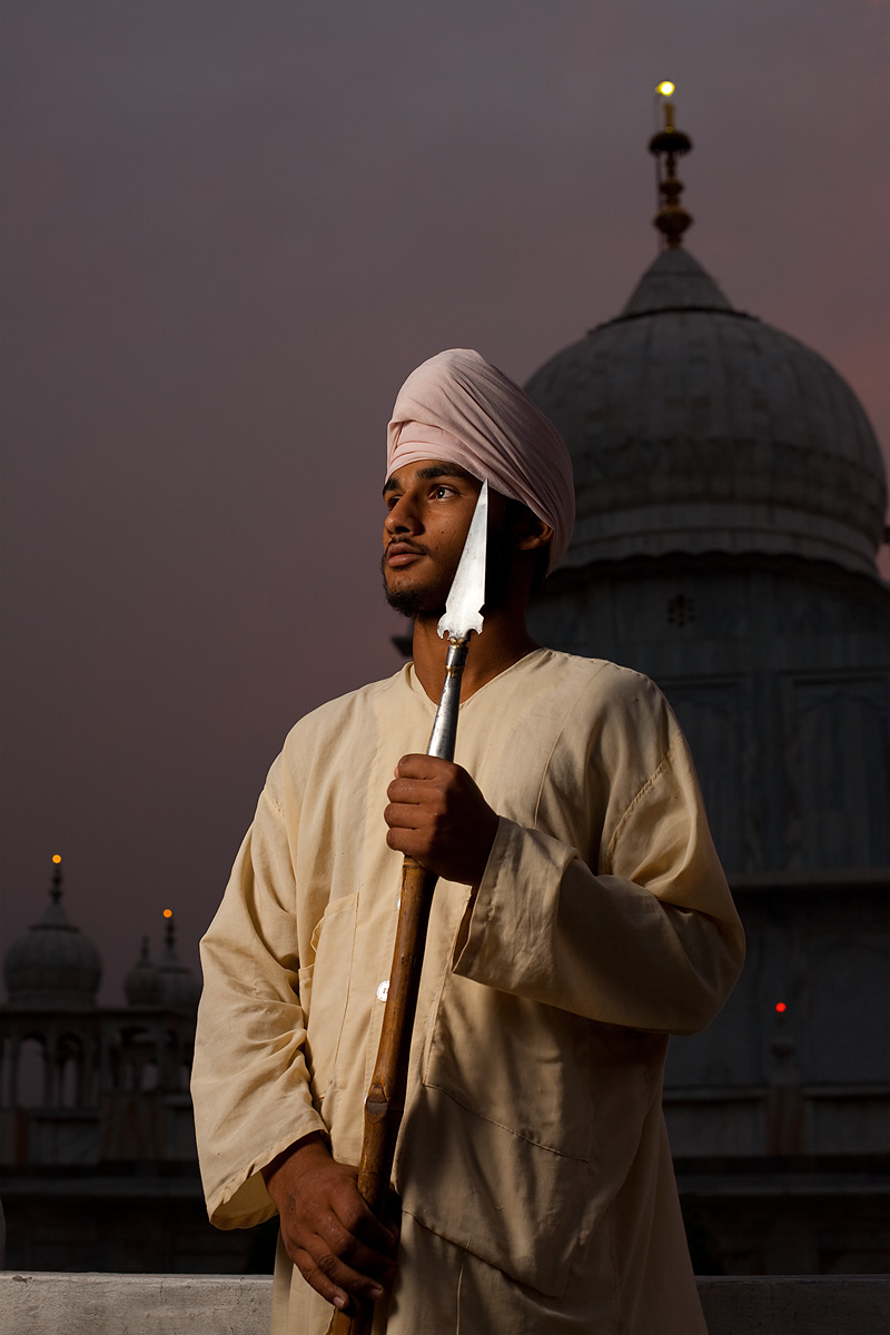 A young man brandishes a spear at the Paonta Sahib Gurudwara. - Paonta Sahib, Himachal Pradesh, India - Daily Travel Photos