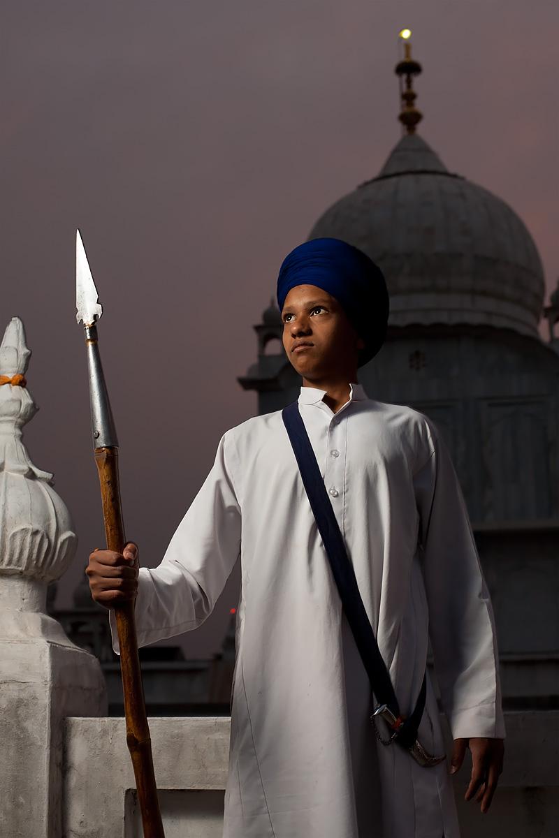 A Sikh teenager poses with lance and ornamental dagger at the Paonta Sahib Gurudwara. - Paonta Sahib, Himachal Pradesh, India - Daily Travel Photos