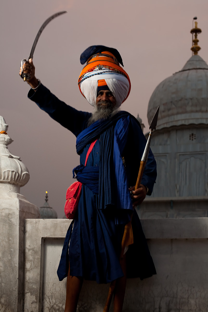 The learned leader of the Paonta Sahib gurudwara stands victorious with sword and spear. - Paonta Sahib, Himachal Pradesh, India - Daily Travel Photos