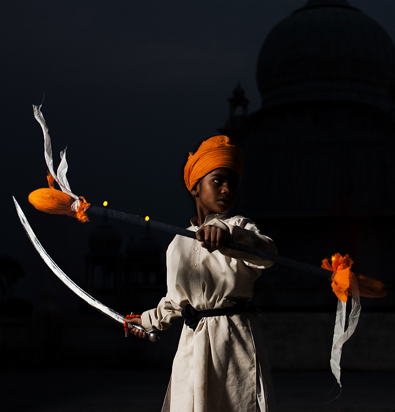 A young Sikh boy practicing martial arts and sword combat at the Paonta Sahib gurudwara. - Paonta Sahib, Himachal Pradesh, India - Daily Travel Photos