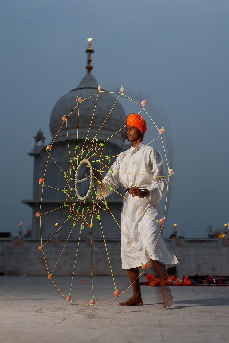 A Sikh student at the Paonta Sahib gurudwara practices martial arts with a net-like weapon. - Paonta Sahib, Himachal Pradesh, India - Daily Travel Photos