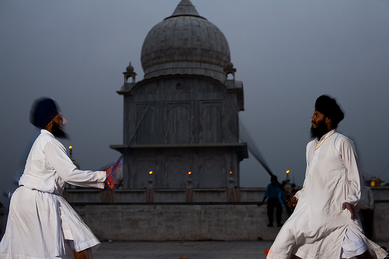 Two Sikhs show off their sword-play at the Paonta Sahib gurudwara. - Paonta Sahib, Himachal Pradesh, India - Daily Travel Photos