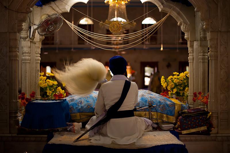 Services at the altar inside the Paonta Sahib Gurudwara. - Paonta Sahib, Himachal Pradesh, India - Daily Travel Photos