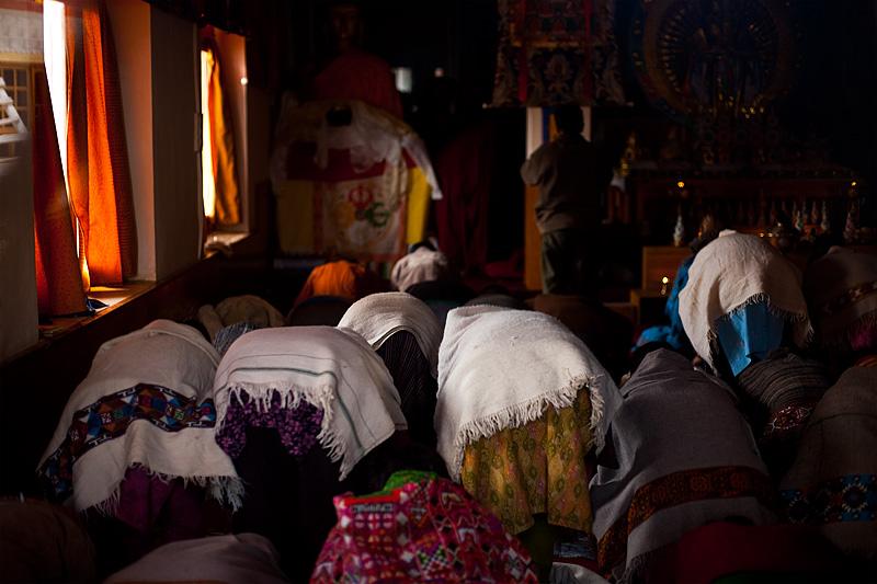Buddhists pray inside a natural-light only monastery. - Dhankar, Himachal Pradesh, India - Daily Travel Photos