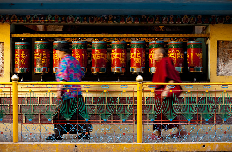 Tibetan Buddhists spin prayer wheels at a temple. - Dharamsala, Himachal Pradesh, India - Daily Travel Photos