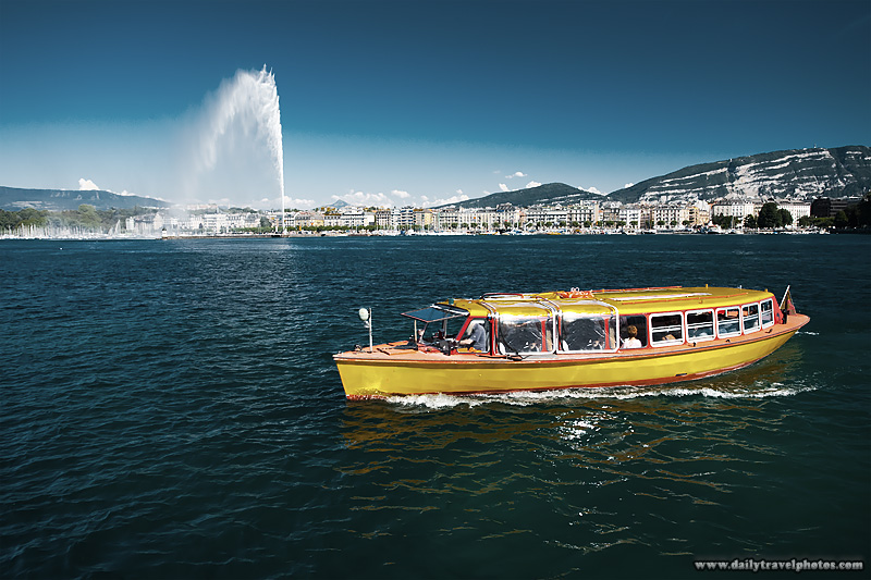 Water taxi on Lake Geneva with jet d'Eau water fountain. - Geneva, Switzerland - Daily Travel Photos