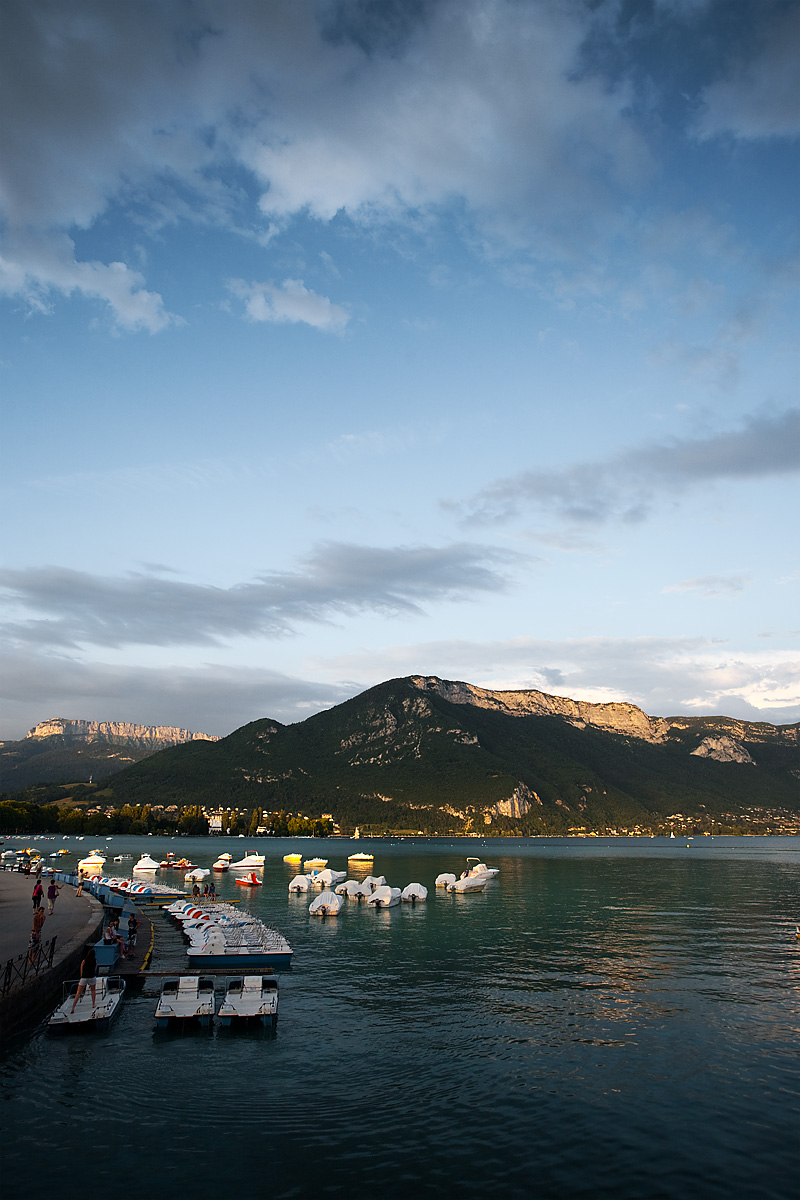 Paddle-boats on Annecy lake surrounded by the Alps - Annecy, France - Daily Travel Photos