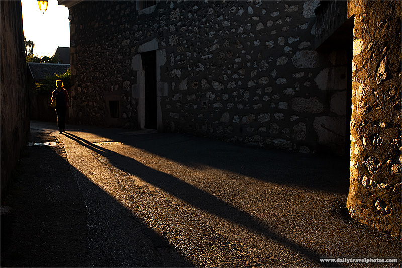 Woman and shadow on old alleyway near old town. - Annecy, Haute-Savoie, France - Daily Travel Photos