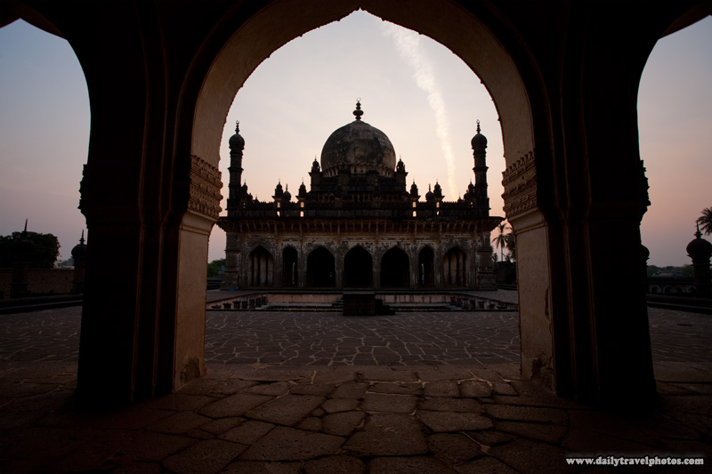 Ibrahim Rauza mausoleum framed by an arch at sunrise - Bijapur, Karnataka, India - Daily Travel Photos