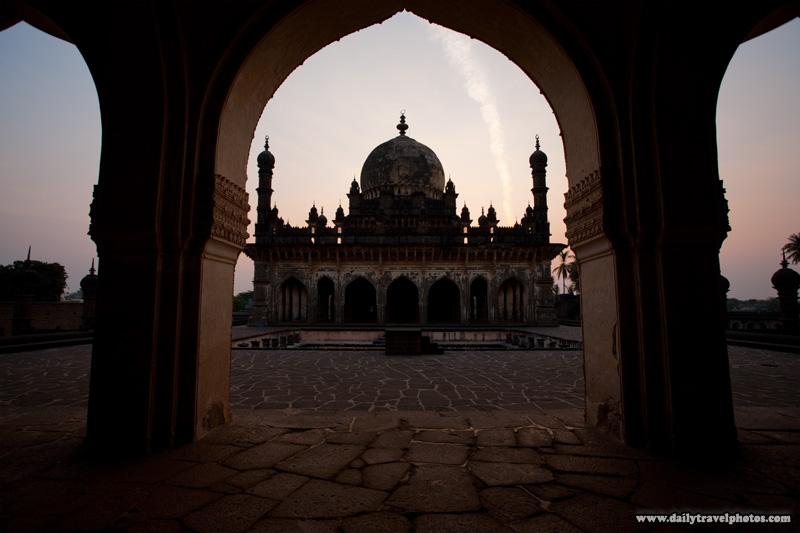Ibrahim Rauza mausoleum framed by an arch at sunrise - Bijapur, Karnataka, India - Daily Travel Photos