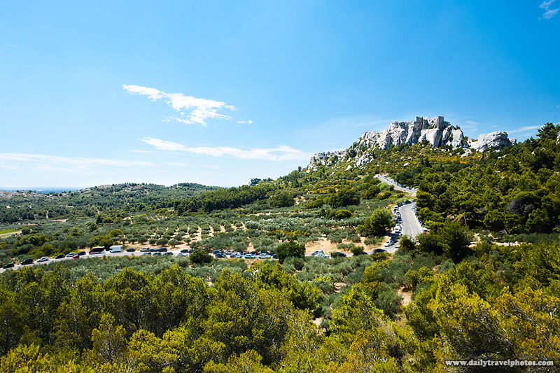 Chateau des Baux lies in ruins atop a mountain surrounded by Provencal fields - Les Baux, Provence, France - Daily Travel Photos