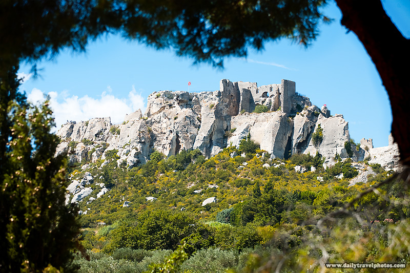 Mountain castle framed by trees - Les Baux, Provence, France - Daily Travel Photos