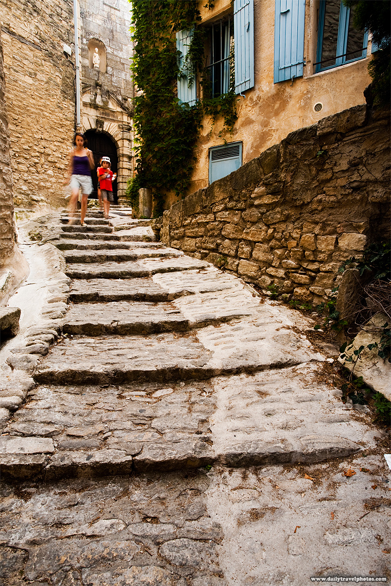 A hilly stone path alleyway of a Provencal village. - Gordes, Provence, France - Daily Travel Photos