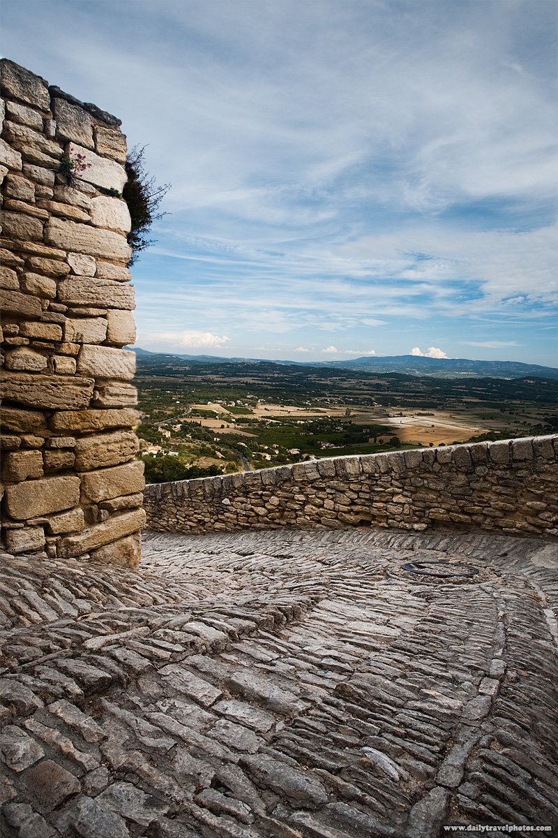 Stone steps path with a spectacular view to the Provencal valley below. - Gordes, Provence, France - Daily Travel Photos