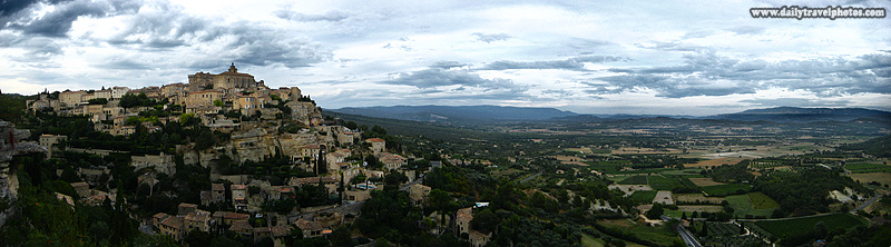 Panorama of a beautiful hilltop village among the fields of Provence - Gordes, Provence, France - Daily Travel Photos