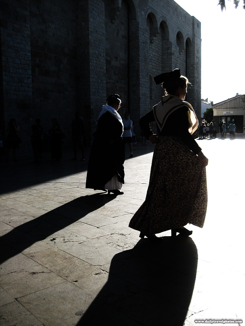 Traditionally dressed women in period costume perform a dance at the church square - Saintes Maries de La Mer, Provence, France - Daily Travel Photos