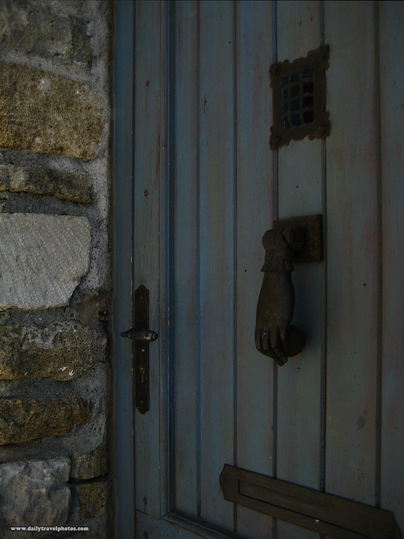 Unique door knocker metal hand and ball on a hinge - Grignan, Provence, France - Daily Travel Photos
