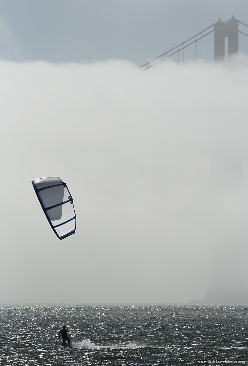 A lone kiteboarder  on a foggy day near the base of the Golden Gate Bridge - San Francisco, California, USA - Daily Travel Photos