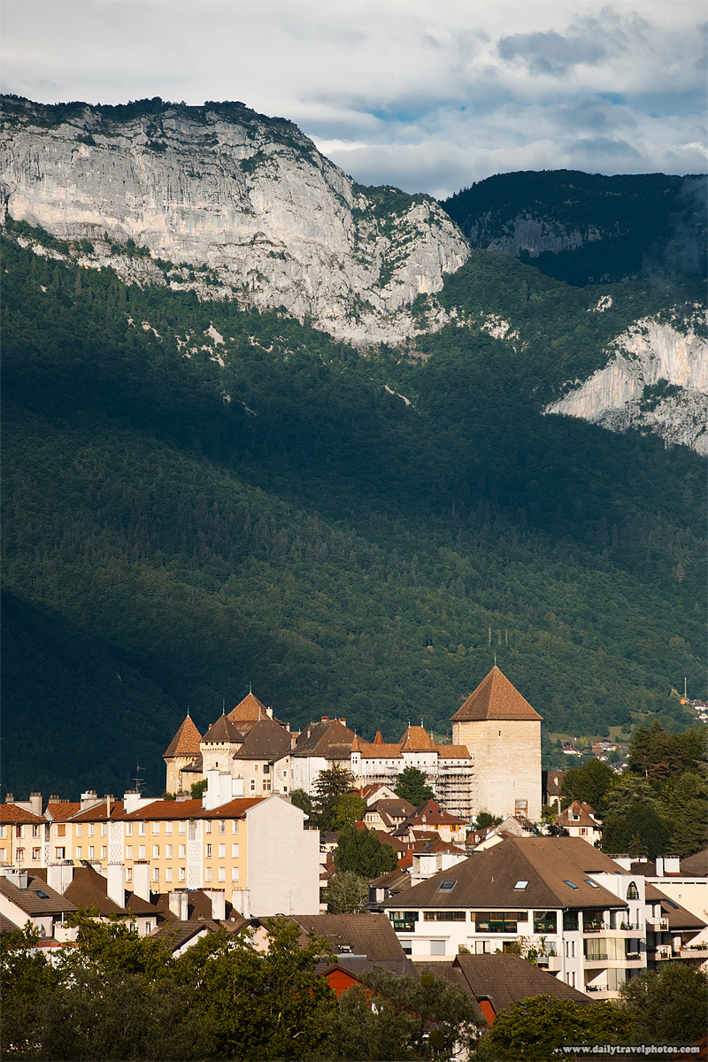 Historic castle chateau in old town background mountains Alps - Annecy, Haute-Savoie, France - Daily Travel Photos