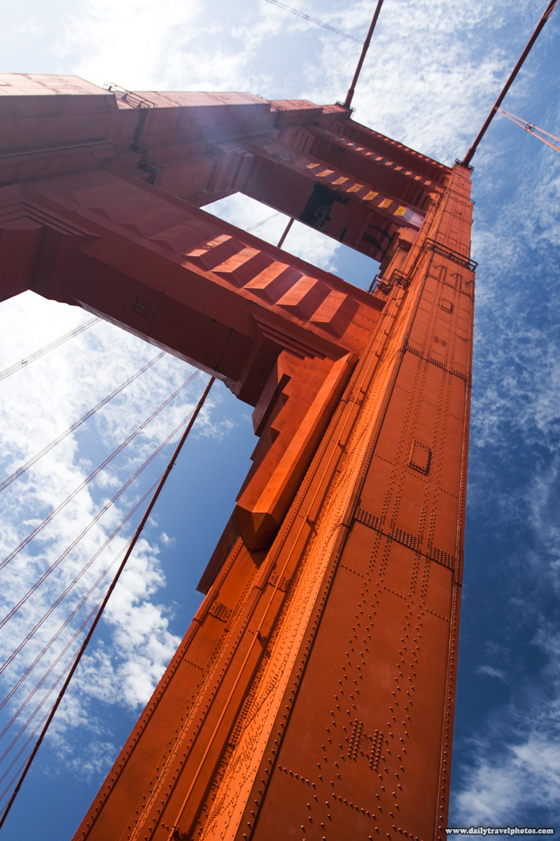 Lens flare closeup Golden Gate Bridge Tower- San Francisco, California, USA - Daily Travel Photos