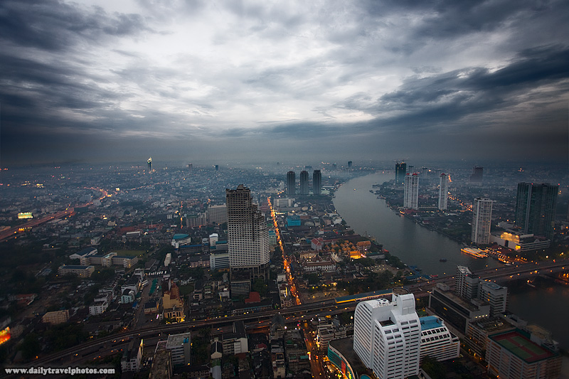 Downtown Bangkok cityscape and aerial view seen from the State Tower's Sirocco sky bar Chao Phraya river clouds - Bangkok, Thailand - Daily Travel Photos