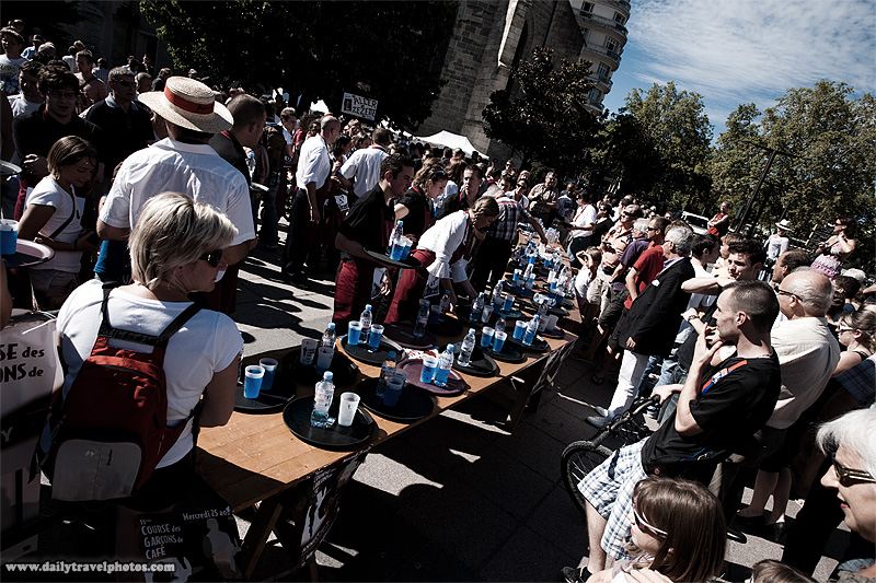 Finish line chaos and crowds at the Waiter's Run competition - Annecy, Haute-Savoie, France - Daily Travel Photos