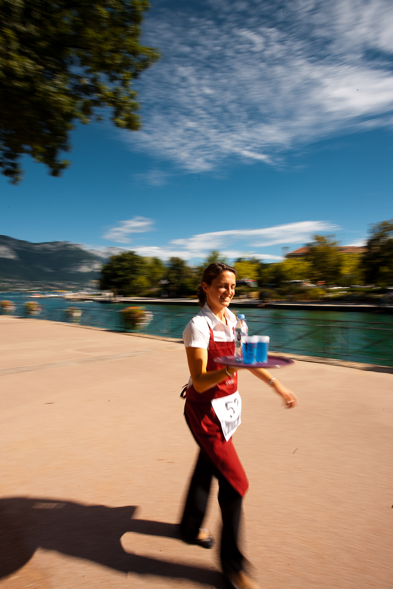 Cute waitress hamming for the camera nearly drops her drinks at the Waiter's Run - Annecy, Haute-Savoie, France - Daily Travel Photos