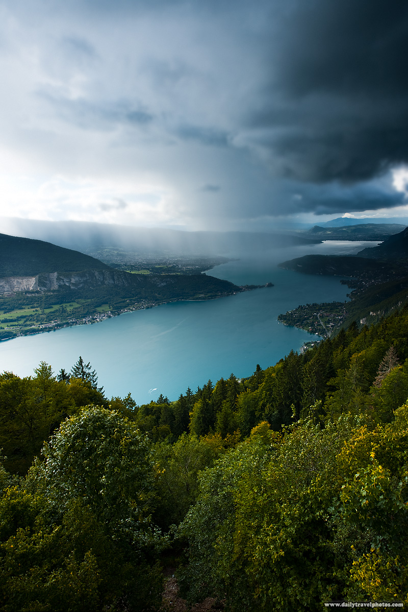 A recreational boater on Annecy Lake from a panoramic viewpoint on a stormy afternoon - Col de La Forclaz, Haute-Savoie, France - Daily Travel Photos