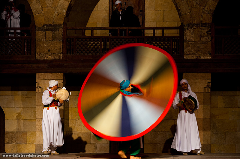 Whirling Dervish performer blurred by slow shutter speed - Cairo, Egypt - Daily Travel Photos
